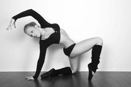 elegant female dancer stretching Stock Photo