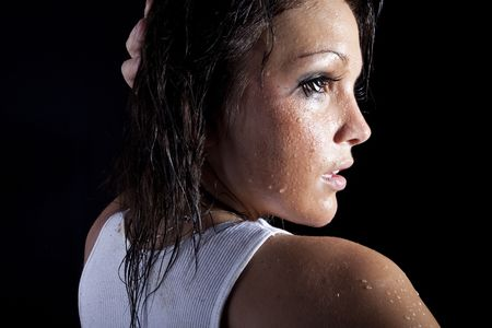 beautiful brunette wet  in white tank top  photo
