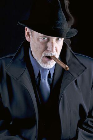 serious men smoking a cigar