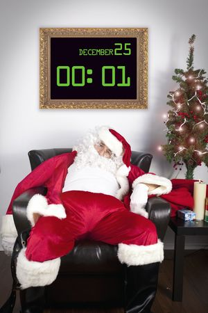 tired: santa exhausted after delivering all the gift Stock Photo