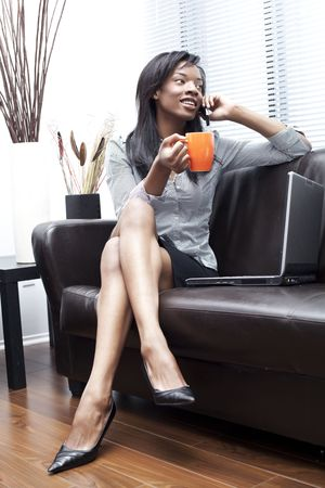 black businesswomen on the phone having a coffee photo