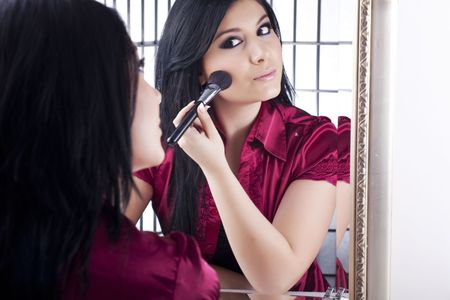 woman mirror: applying make-up Stock Photo