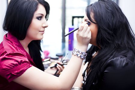 makeup artist at work Standard-Bild