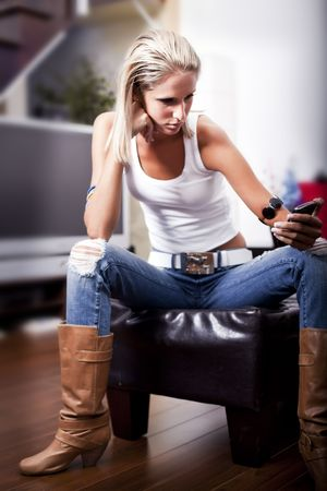 young girl sitting texting photo