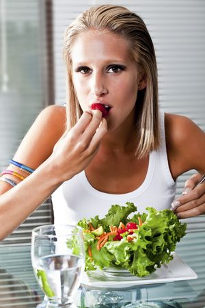 beautiful young women eating a salad