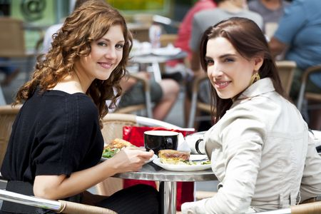friends sitting outside having lunch Stock Photo - 7745996