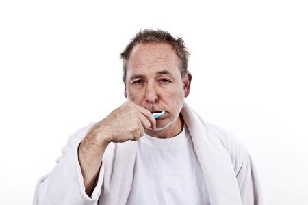 men brushing teeth