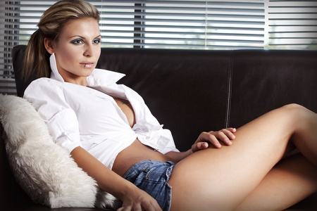 seduction: beautiful young women sitting at home