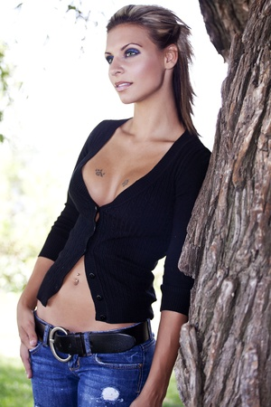 provocative woman: beautiful young women at the park Stock Photo