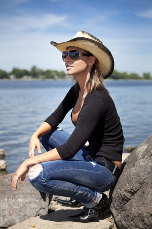 beautiful young women outside by the river photo