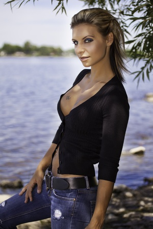beautiful blond women outside by the river Reklamní fotografie - 10646446