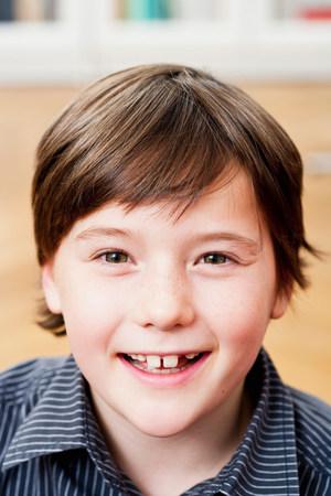 naive: Boy smiling to camera, portrait Stock Photo