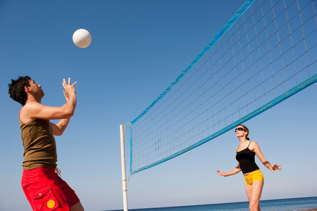 Couple Playing Beach Volleyball Stock Photo