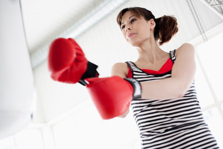 Woman trying out boxing