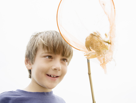 Boy with crab in net