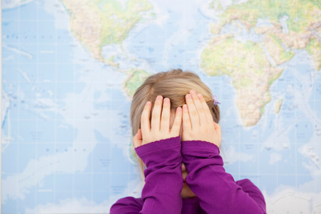 german ethnicity: young girl hiding face with hands Stock Photo