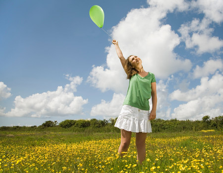 Woman in Meadow with Balloon
