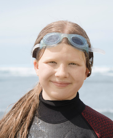 Girl in wet suit with goggles Stock Photo