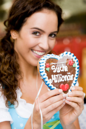 Young Woman With Gingerbread Heart Stock Photo