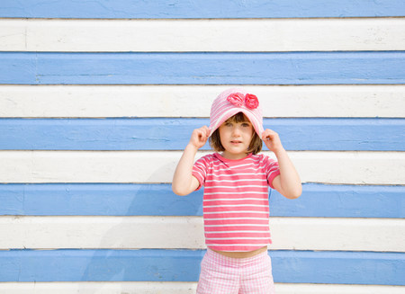 Girl in front of beach hut Stock Photo