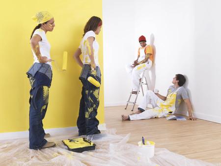 Girls painting men take break.