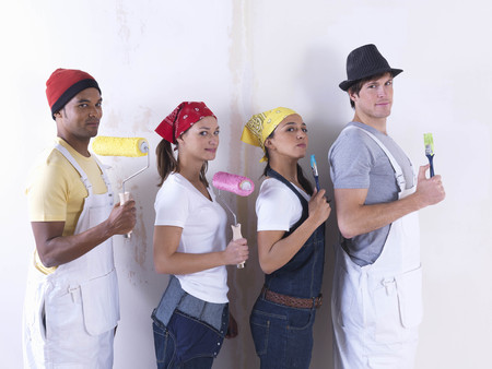 Group of friends about to paint wall.