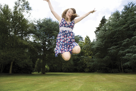 Girl jumping in garden