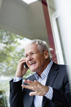 Senior Businessman Using Cellphone Stock fotó
