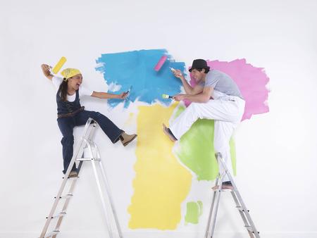 Couple posing on ladders. 스톡 콘텐츠