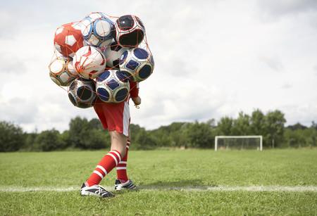 Footballer struggles with bag of balls
