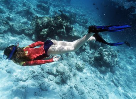underwater shot of girl snorkeling Stock Photo