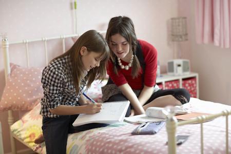 shared sharing: Teenage girls doing homework