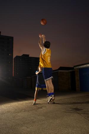 A basketball player jumping and shooting