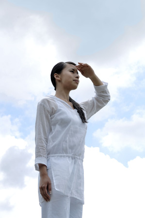 Woman looking at the horizon Stock Photo