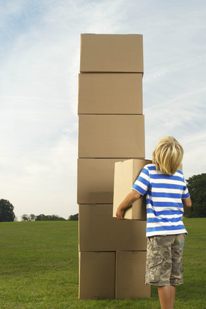 boy looking at box tower
