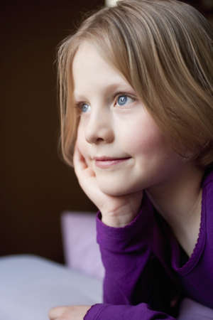trusted: young girl daydreaming Stock Photo