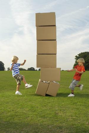 boys kicking boxes Banco de Imagens