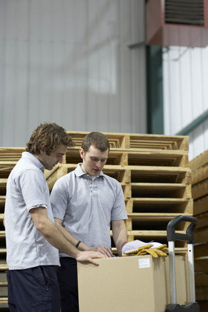 Two workers in warehouse