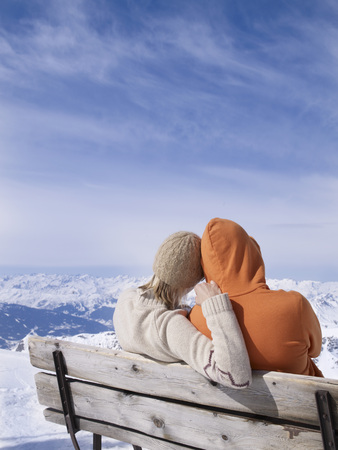 couple on bench hugging Stock Photo