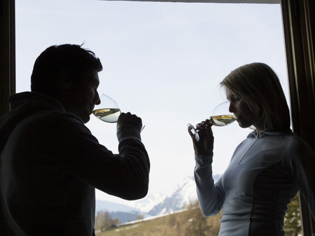 woman and man at window drinking Stock Photo