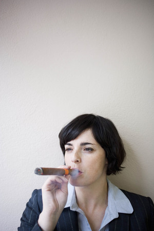 businesswoman smoking cigar