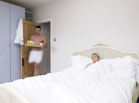 Man and woman in bedroom Stock Photo