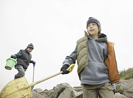Boys on beach rocks
