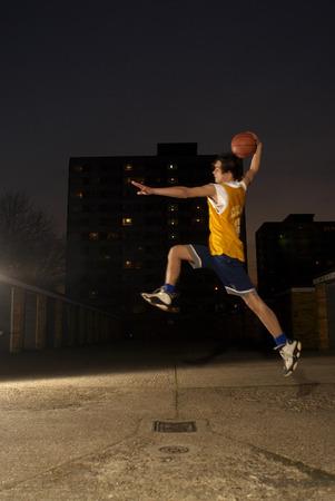 basketball player jumping Banco de Imagens - 86032172