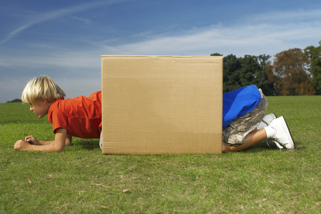 two boys crawling into box Imagens