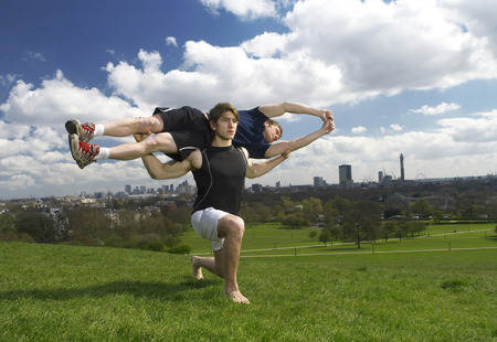 man lunging holding friend Stock Photo
