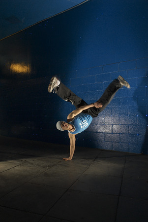 man doing one hand stand