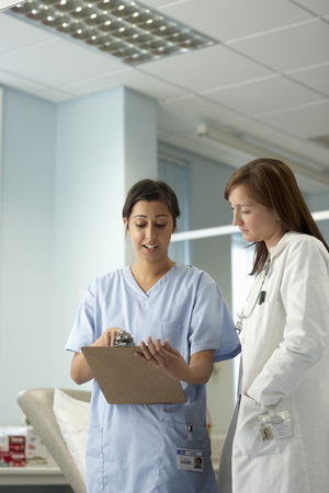 Nurse and doctor in discussion