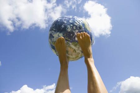 Globe balancing on feet