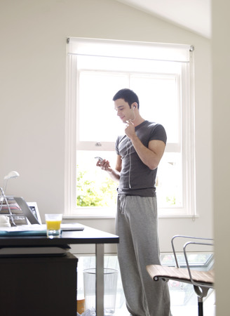 Man with headphones in home office